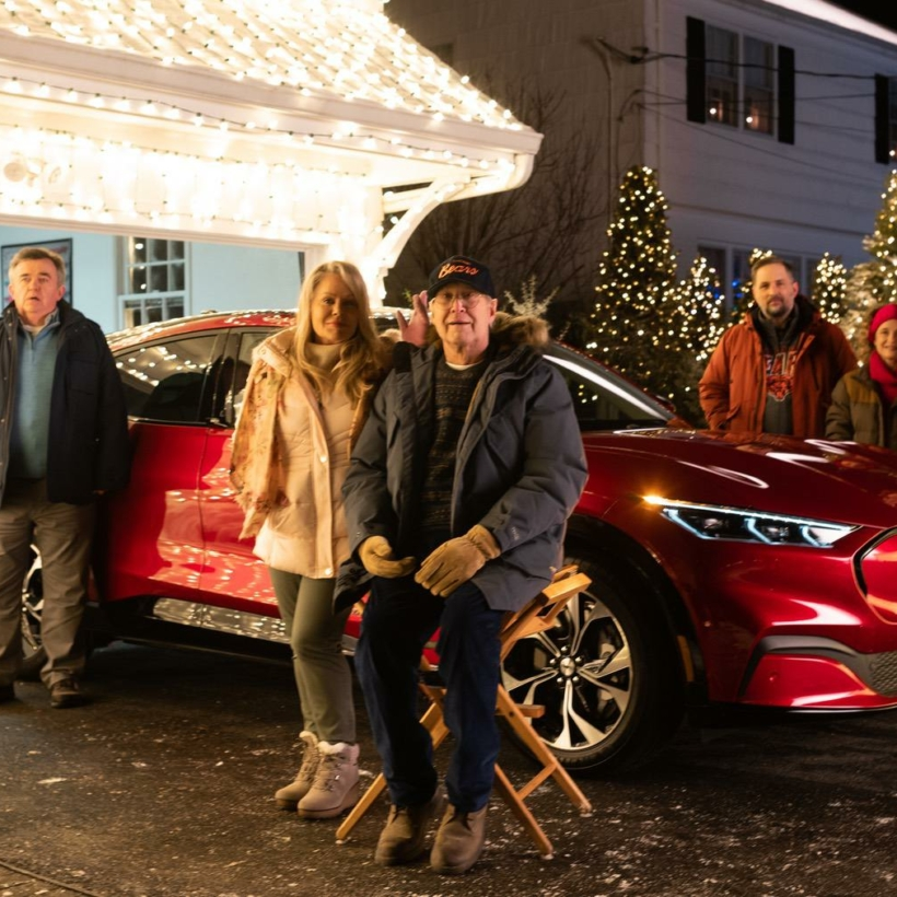 """Chevy Chase and Beverly D'Angelo reprise their """"National Lampoon's Christmas Vacation"""" roles as Clark and Ellen Griswold in an updated take on one of the 1989 holiday classic's most iconic scenes – starring Mustang Mach-E.  Photo Credit: Emily Chase"""